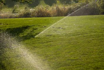 in ground sprinklers in Cedar Hill Texas irrigate a lawn